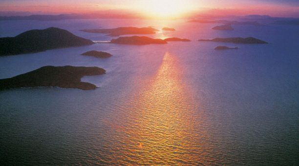 See the sun set and rise over the Whitsunday Islands