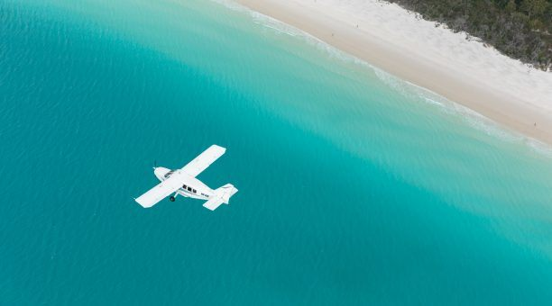 Flying low level along Whitehaven Beach